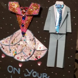 image shows an origami dress and suit on a card
