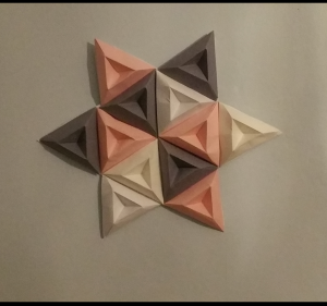 image shows a star made from origami triangles